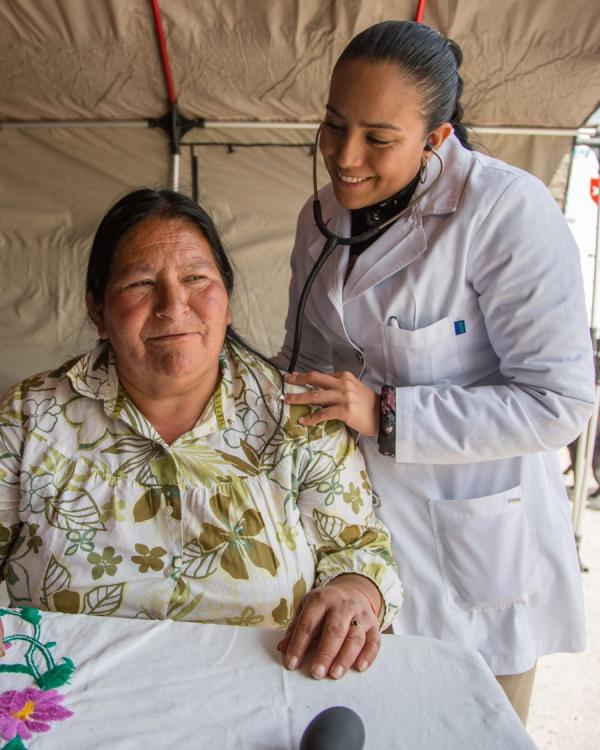 Healthcare worker caring for a woman in Mexico